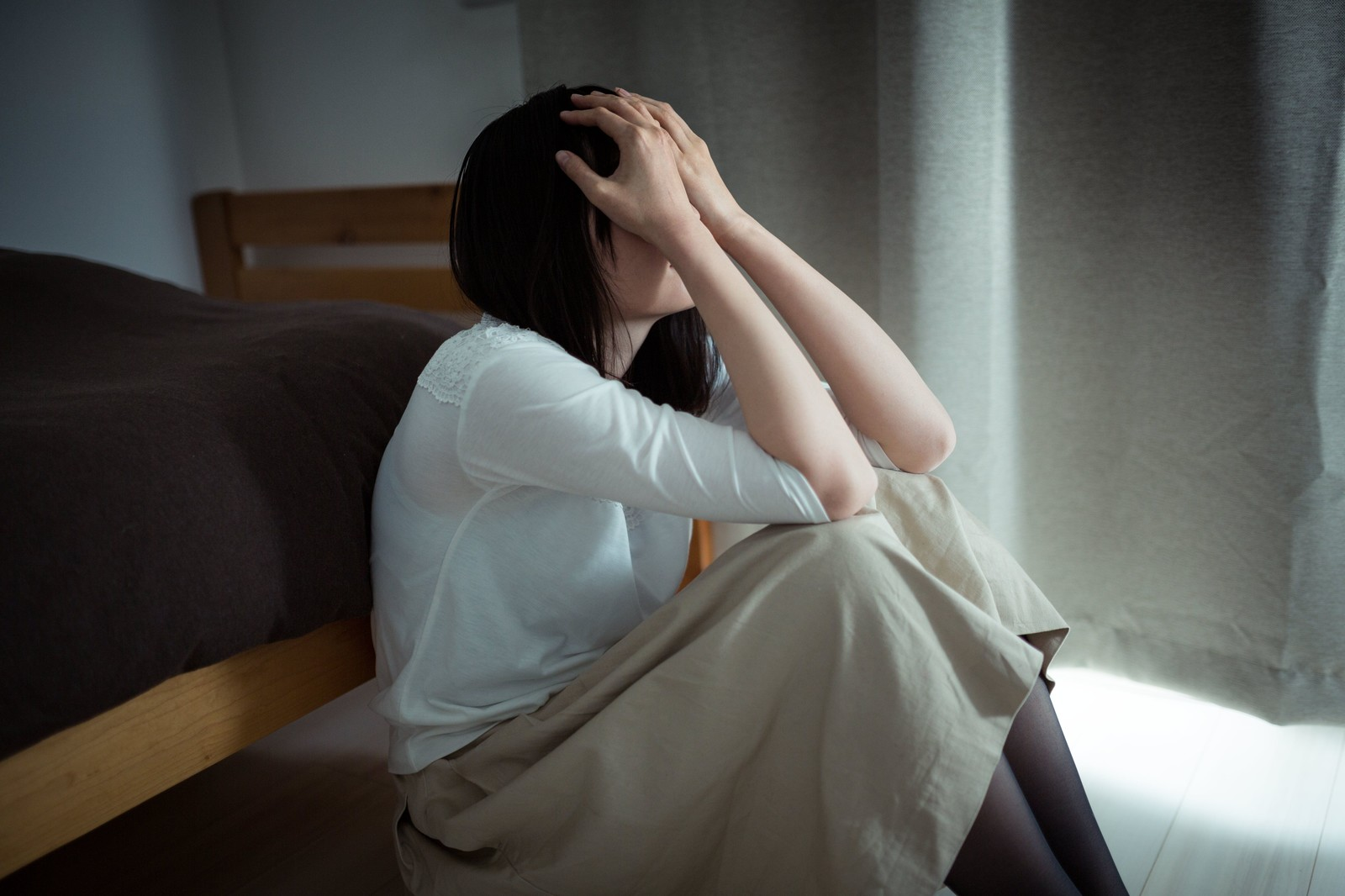 憂鬱そうな女性